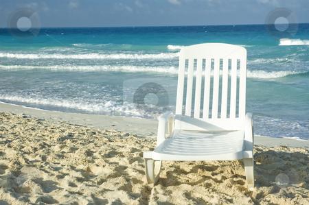 Beach stock photo, White plastic long chair on a sandy beach by Vlad Podkhlebnik