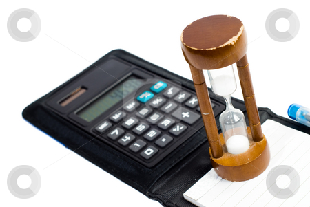 Calculations stock photo, An hourglass and a calculator isolated against a white background by Richard Nelson
