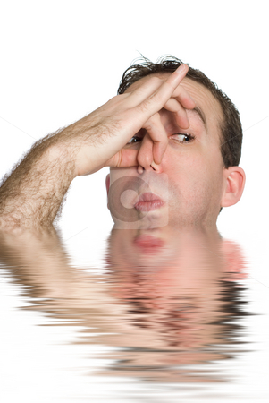 Man About To Drown stock photo, A young man holding his breath as he is about to drown in water by Richard Nelson