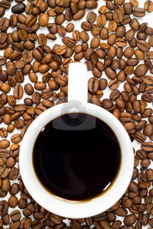Caffeine stock photo, An overhead view of a cup of coffee and beans by Richard Nelson