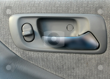 Parts of a car stock photo, Door and door controls in a car by Albert Lozano