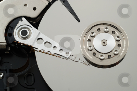 Close up of hard drive stock photo, Close up pictures of the interior of a computer hard drive by Albert Lozano