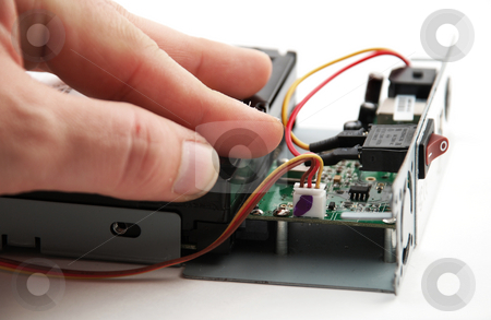 Electronic parts and circuits stock photo, Pictures of the interior of a consumer electronics product showing the different components by Albert Lozano