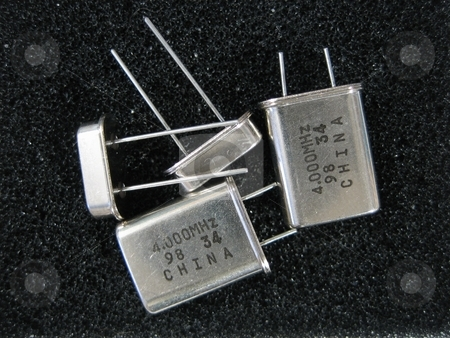 Electronic components stock photo, Electronic components and parts for circuits and other equipment by Albert Lozano
