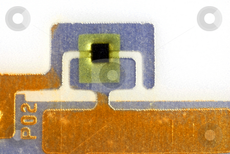 Close ups of tags stock photo, Close up pictures of a RFID tag showing the chip and antennas by Albert Lozano