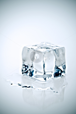 Cross Processe icecube melting on a white reflective surface stock photo, Cross Processe image of an icecube melting on a white reflective surface by Vince Clements