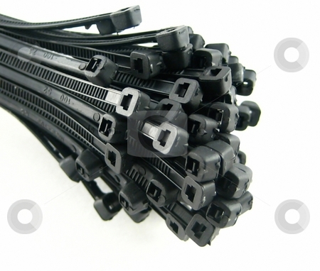 Cable ties stock photo, Ties to arrange cables for electronic equipment by Albert Lozano