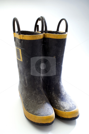Dirty boots stock photo, A pair of dirty rubber boots on white by Jonathan Hull