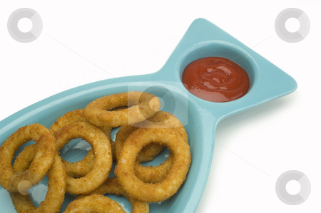 Onion rings stock photo, Anorder of onion rings with ketchup on white by Jonathan Hull