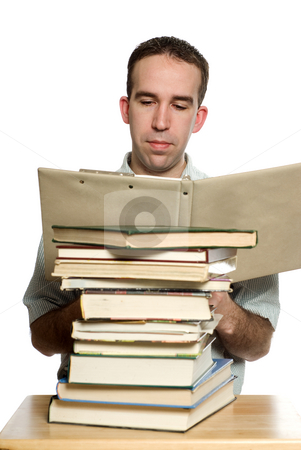 Student Reading stock photo, A student studying his notes from a binder, isolated against a white background by Richard Nelson