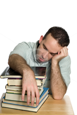 Tired College Student stock photo, A tired college student is sleeping on a large pile of books, isolated against a white background by Richard Nelson