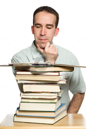 University Student Studying stock photo, A male university student studying a book, isolated against a white background by Richard Nelson