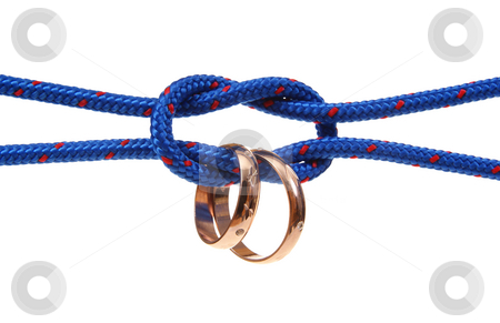 Wedding stock photo, Connected strings with golden wedding rings isolated on white background by Jolanta Dabrowska