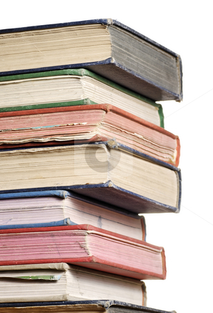 Stack of books three quarter stock photo, A close up stack of books isolated against white by Paul Turner