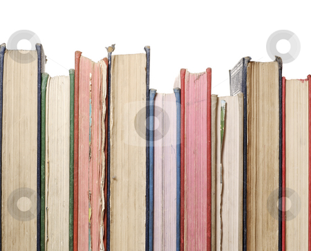 Row of old books stock photo, A close up row of books isolated against white by Paul Turner