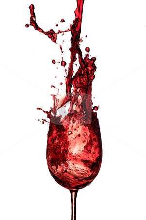 Red wine splash stock photo, Red wine being poured in to a wine glass from a height by Paul Turner