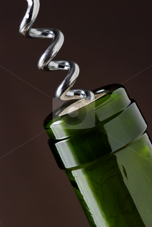 Uncorking stock photo, Macro close up of corkscrew in wine bottle cork by Paul Turner