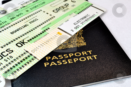 Passport and boarding pass stock photo, Canadian passport and air travel boarding pass. by Fernando Barozza