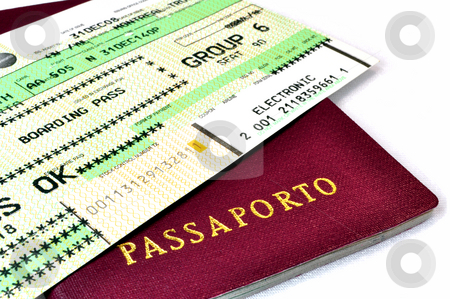 Passport and boarding pass stock photo, Italian passport and air travel boarding pass. by Fernando Barozza