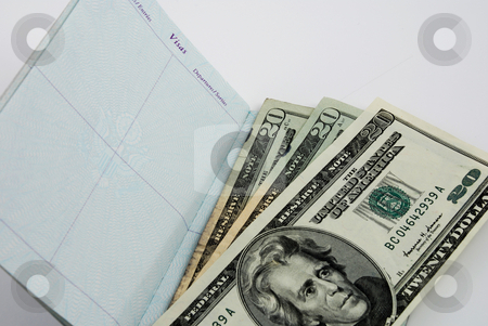 Business travel stock photo, Pictures showing a US passport with American dollars by Albert Lozano
