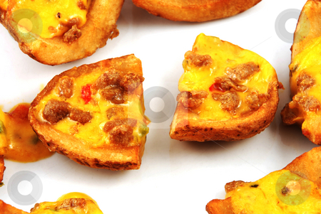 Potato skin stock photo, Stock pictures of potato skins loaded with chesse and bacon by Albert Lozano