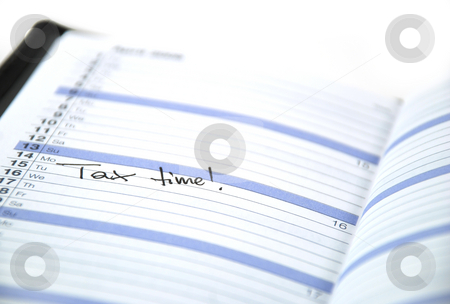 Tax time stock photo, Daily planner with appointment for doing taxes by Albert Lozano