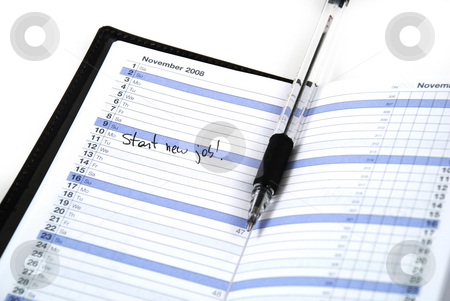 New job stock photo, Daily planner showing the first day of a new job by Albert Lozano