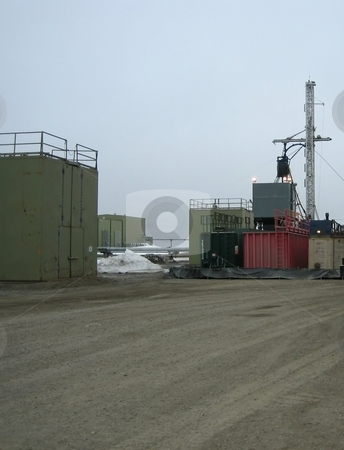 Oil extraction site stock photo, Oil and petroleum extraction site including drilling wells and pipeline for transportation of crude oil by Albert Lozano