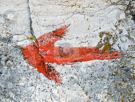 Painted arrow stock photo, Painted arrow on a grunge rock. by Sinisa Botas