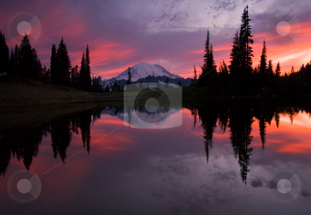 Red Sky at Night stock photo, Unbelievable sunset color paints the evening sky over Mt. Rainier as it reflects in a still alpine lake. by Mike Dawson