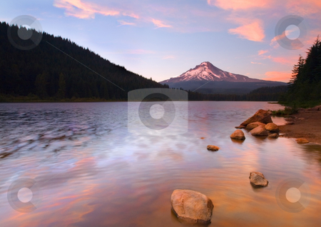 Windkissed Reflection stock photo, Sunset over the winddriven waters of Trilium Lake with Mt. in the distance by Mike Dawson