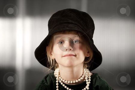 Girl with big hat stock photo, Funny young girl wearing a big floppy hat by Scott Griessel