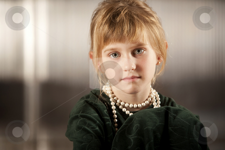 Cute young girl with big eyes stock photo, Cute young girl with big eyes in dress-up clothes by Scott Griessel