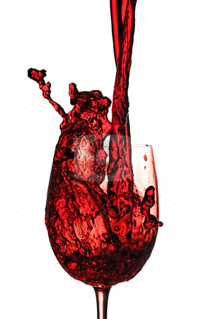 Red wine pour stock photo, Red wine being poured in to a wine glass from a height by Paul Turner