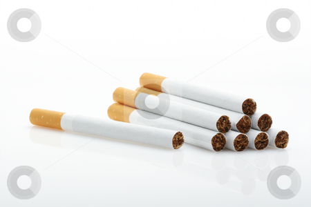 Cigarettes over white background stock photo, Cigarettes over white background.Unsharpened. by Ivelin Radkov
