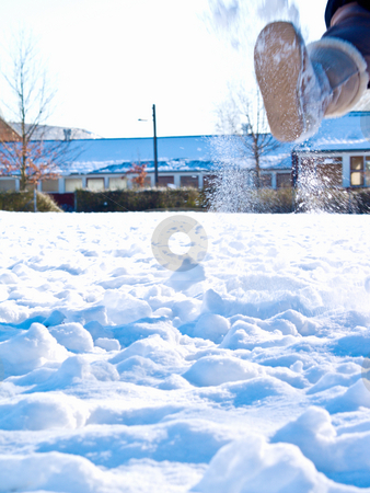 Boot kicking up snow in a field stock photo, Boot kicking up snow in a field by Phillip Dyhr Hobbs