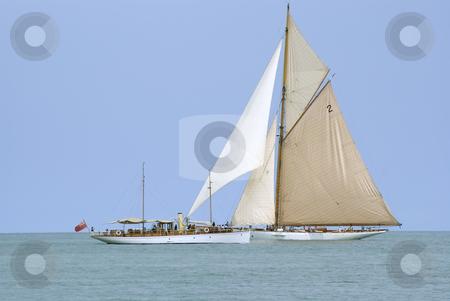 Regatta stock photo, And historic sailboat crossing an old motor boat during a regatta. by Serge VILLA