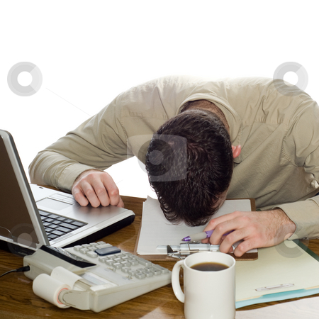 Depressed Businessman stock photo, A depressed businessman lying with his head on his desk, isolated against a white background by Richard Nelson