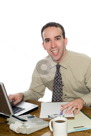 Young Lawyer stock photo, A happy young lawyer smiling at his desk, isolated against a white background by Richard Nelson