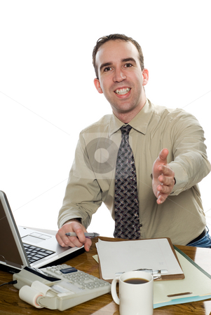 Businessman Shaking Hand stock photo, A smiling young businessman is offering his hand for a shake, isolated against a white background by Richard Nelson