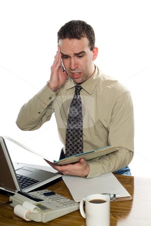 Headache stock photo, A young office worker suffering from a headache, isolated against a white background by Richard Nelson