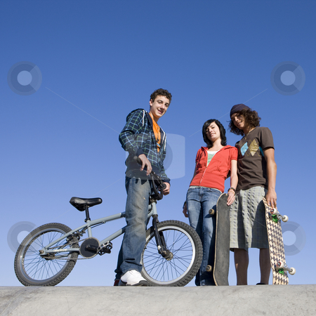 Teens at skatepark stock photo, Teens hang out at the skatepark by Rick Becker-Leckrone