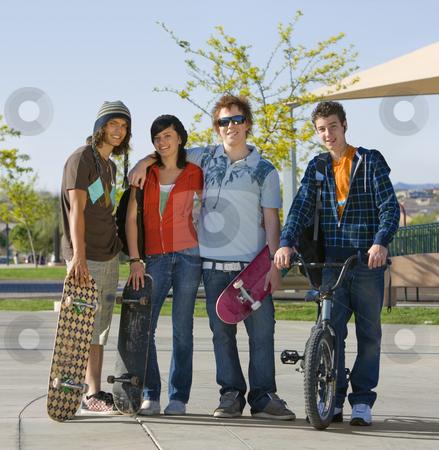 Kids at the park stock photo, Four kids hang out at the park by Rick Becker-Leckrone