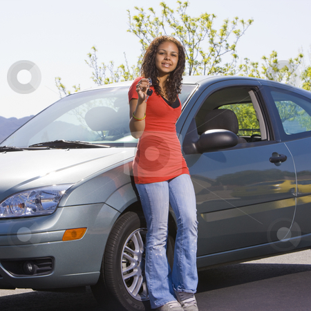 Happy teen with keys to car  stock photo, Happy teen holds up car keys and smiles by Rick Becker-Leckrone
