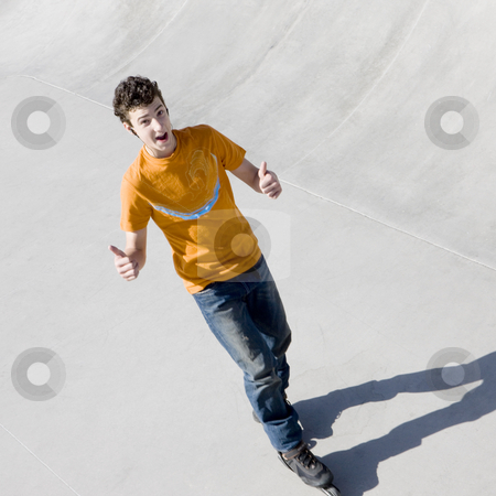 Rollerblader in skatepark stock photo, Rollerblader in skatepark gestures a thumbs-up by Rick Becker-Leckrone