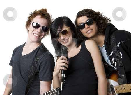 Three bandmates stock photo, Three bandmates with instruments in a studio by Rick Becker-Leckrone