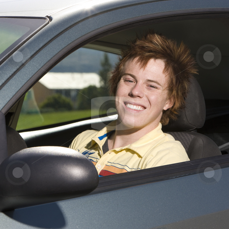 Happy teen in car stock photo, Happy teen in car by Rick Becker-Leckrone