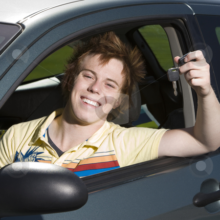 Happy teen in car stock photo, Happy teen with keys to car by Rick Becker-Leckrone