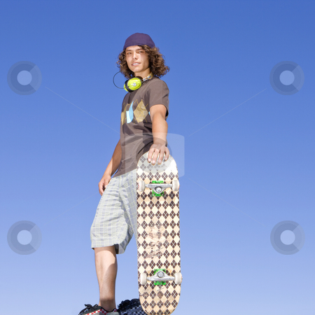 Teen skater atop ramp stock photo, Teen skater atop ramp by Rick Becker-Leckrone