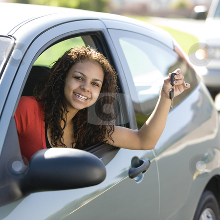 Teen driver with keys  stock photo, Teen driver inside car with keys smiles by Rick Becker-Leckrone